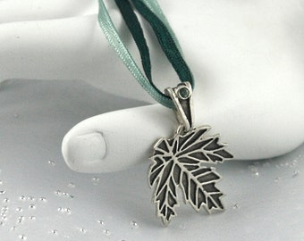 Maple Leaf necklace with a green tourmaline. Canadian jewelry. Front page featured.