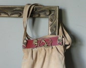 Vintage handbag purse boho suede and leather purse with a stylized brass metal lion on the front double shoulder strap