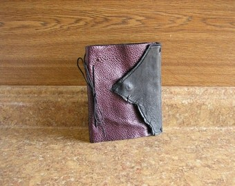 "Leather covered Photo Book in Purple pebbled leather and black deerskin,and a magnetic snap,  5"" x 6"" with 20 pages"
