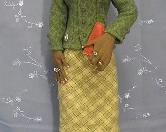 Jade, 17 inch tall cloth African American soft sculpture doll dressed in green jacket and print skirt