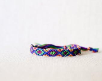 Friendship Bracelet Tribal Diamond Pattern Purple Green Peach and Blue