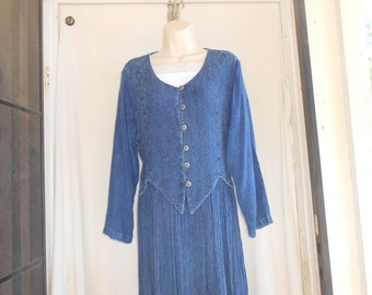 Vintage blue jean 70s floor length maxi dress. Size medium. 1970s. Button up built in vest. Ties in the back.