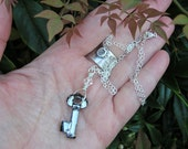 "yoko ono signature swarovski key and sterling silver filled necklace. collectible ""silver night"" key pendant necklace. key to the forest."
