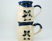 pair of panda mugs sold together