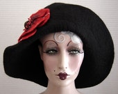 Black Felted Winter Hat With Attached Red Felted Flower On Sale