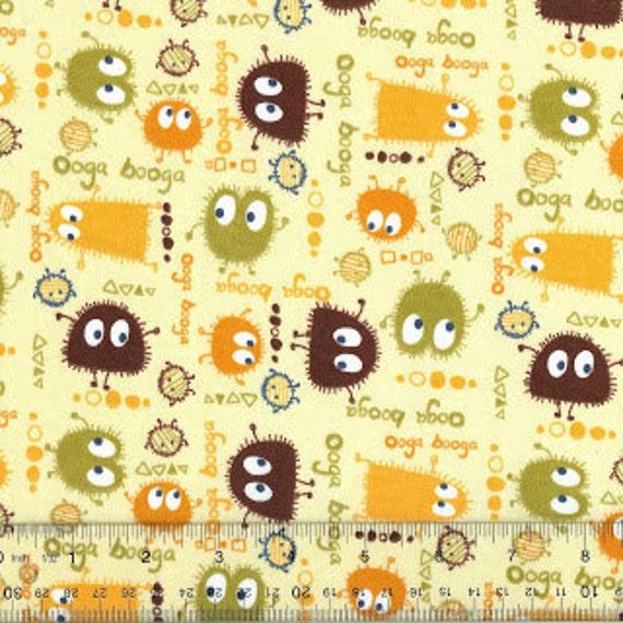Ooga Booga Monsters 1 yd brown, orange, yellow, green on soft yellow background, organic Interlock knit fabric baby clothing