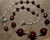 Hand knotted chocolate brown vintage glass beads and Bali sterling silver beaded necklace.