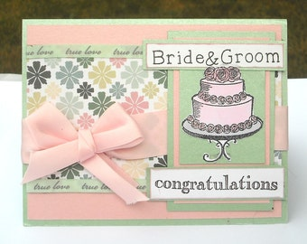 Bride and Groom Congratulations Wedding Day Card, Pink and Mint Green with Wedding Cake, Pink Bow