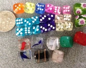 Various colors cube and dice shaped glass beads