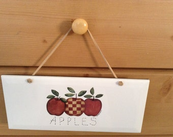 Ceramic Plaque  it is 4 1/4 by 10 With Stitched Apples