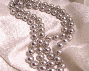 Vintage Trifari Platinum White Faux Pearl Strand. Knotted 24 Inch Strand (J143)