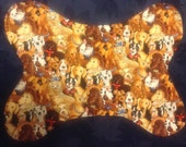 Reversible doggie bone dog bowl mat