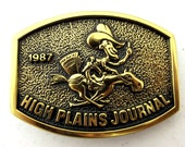 Cowboy on Horse delivery newspaper belt buckle - High Plains Jourmal