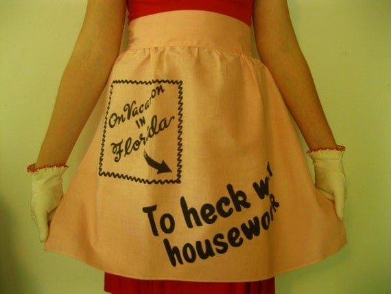 "Vintage Florida souvenir apron ""On Vacation in Florida - To Heck with Housework"" - 1950s pink"