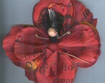 Deluxe Sentiment Flower Fairy with Black Hair and Red and Orange Petals