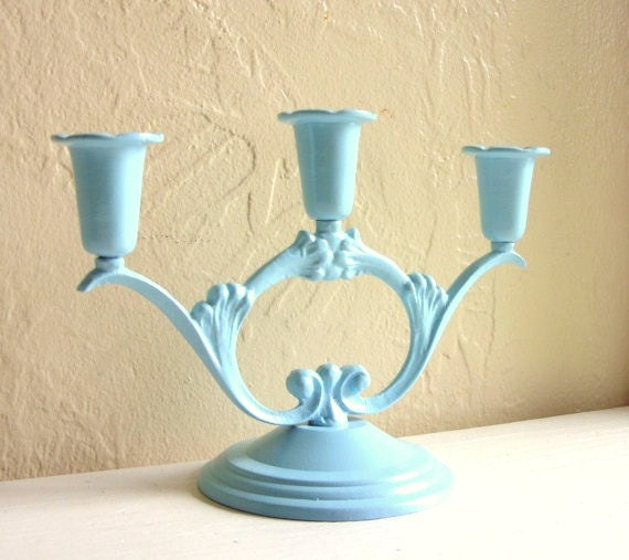 Light bright blue metal candelabra centerpiece for candles