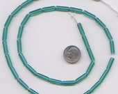 99 Cent Sale:  24 inch strand Sea Green Teal Glass Tube Beads