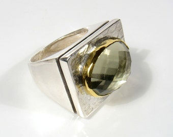 22k gold  framing an oval rose cut stone on silver rectangular ring- Prodigieuse modern ring is a statement ring.