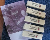 Personalized knitting labels-needles with swirl of yarn