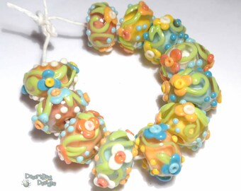 TROPICA Lampwork Beads Handmade Ivory Coral Melon Yellow Blue Floral Vines and Flowers Set of 11