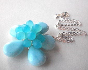 Blue beaded flower necklace, wire wrapped flower with light blue glass beads, flower pendant necklace with silver chain