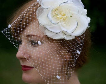 White silk and velvet rose floral wedding fascinator with dotted netting