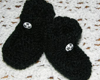 Black booties with a soccer ball button