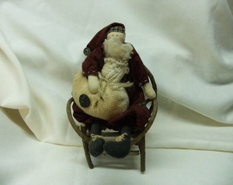 Adorable Santa Sitting in His Twig Chair