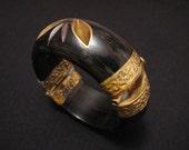 Antique Heavy Repousse Inlaid Brass Leaf and Black Tusk Bone Hinged Bangle Bracelet
