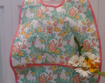 OVERSIZED ADULT BIB: Adult/Bib/Cover-up, special needs item, large , two pockets, cotton flannel backing,velcro closure
