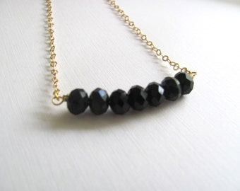 Black geometric faceted glass beads necklace on delicate gold chain