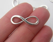 12 Infinity charms or connectors antique silver tone I1