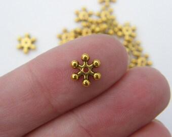 50 Spacer beads antique gold tone GC33