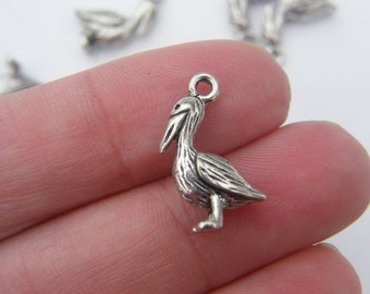 8 Pelican charms antique silver tone B87