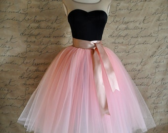 Vintage pink lined tulle skirt with satin ribbon sashed adult tutu. Romantic tea length.