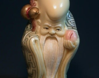 Vintage Japanese ivory colored bone netsuke -Longevity man with Ruyi offer peach,signed
