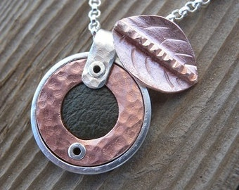 Small Round Sterling and Copper Pendant Inset with Green Leather Including a Copper Leaf