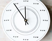 "now clock porcelain 8.25"" stamped text."