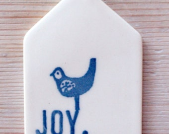 porcelain wall tag screenprinted text joy with bird.
