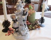 Figurine Children Picking Apples in Blue and White Porcelain by KPM