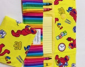 50% OFF Elmo Crayon Tote in a colorful print complete with 12 crayons and a paper pad
