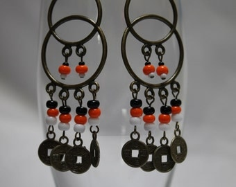 Orange, black and white beads on double hoop earrings with chinese coins