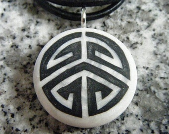 Puzzle hand carved on a polymer clay pearl color background. Pendant comes with a FREE  Necklace