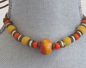Vintage Orange and Gold Beads, Brass Washers and a Leather Tie Choker