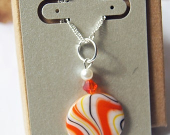 Abstract Design Round Pendant.   Beaded necklace. Retro 1960 Hippy .Pearl Crystal  - Geometric Orange Yellow White Stripe. Sterling Chain