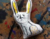 yellow and mint pocket sized rabbit plush ornament. Small embroidered, screen printed bunny toy. stocking filler