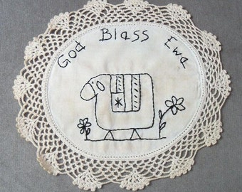 Primitive stitchery on vintage linen