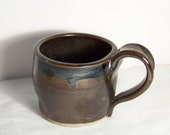 OOAK Coffee Mug glazed in a matte brown with temmoku, black and blue overlays