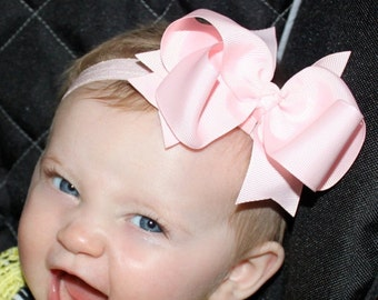 Boutique Pink Large Basic Hair Bow on Pink  Elastic Headband..Perfect for photo props..Newborns Infants Toddlers Girls