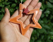 Pottery star ornament in pumpkin orange with cranberry red wooden star accent (ONE)